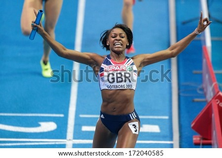 GOTHENBURG, SWEDEN - MARCH 3 Perri Shakes-Drayton (GBR) and her team win the women's 4x400m relay finals during the European Athletics Indoor Championship on March 3, 2013 in Gothenburg, Sweden. - stock photo