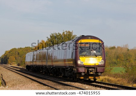 GOTHERINGTON, UK - OCTOBER 28: A X-Country commuter service passes through countryside on route to Cheltenham on October 28, 2014 in Gotherington. X-Country operate a fleet of 96 units across the UK