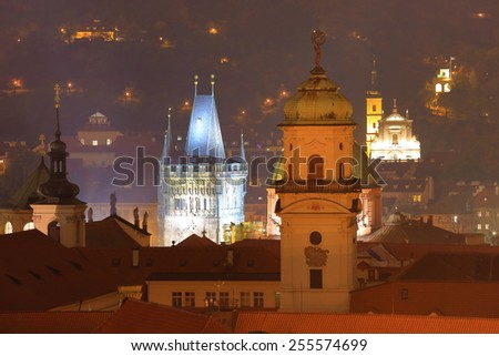 Gothic and church towers illuminated in autumn night, Prague, Czech Republic