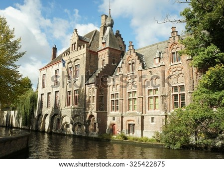 Gothic architecture, beautiful buildings in historical town of Bruges, Belgium - stock photo