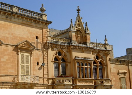 Gothic Architecture on medieval palace in island of Malta - stock photo