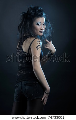 Gothic asian woman on black background