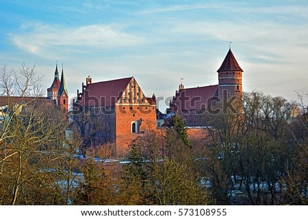Gothic brick old castle and cathedral in winter scenery in Olsztyn (Allenstein), Poland