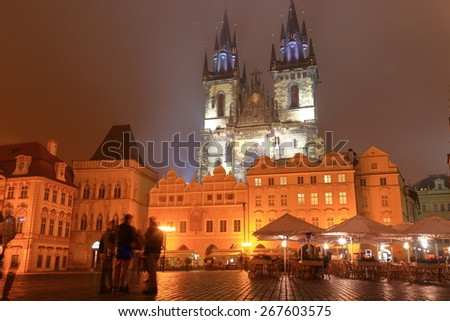 Gothic building of the Church of Our Lady before Tyn visible from the main square of Prague old town in foggy night, Czech Republic - stock photo