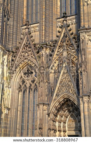 Gothic Cathedral Detail With Stone Sculptures Above The Main Door In Cologne Germany
