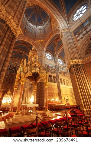 Gothic cathedral interior and altar at night - stock photo