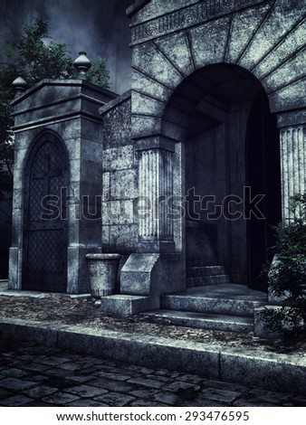 Gothic cemetery crypts with green vines at night - stock photo