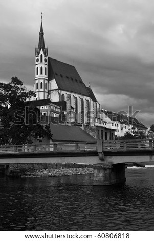 gothic church above a river, black and white - stock photo