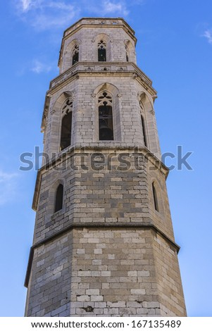 Gothic Church of Saint Peter near Dali's Theatre - Museum building in Figueres, Catalonia, Spain. Belltower.This is Cathedral in which in 1904 young Dali christened. - stock photo