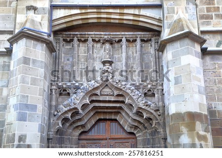Gothic decorations upon the gate to the Black Church (Biserica Neagra) in Brasov, Romania - stock photo
