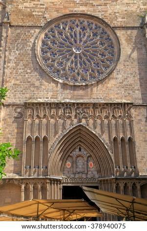 Gothic details on the facade above the main door to Santa Maria del Pi church in Barcelona, Catalonia, Spain - stock photo