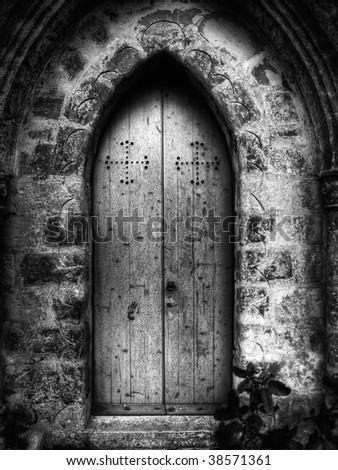 Gothic doorway to St Simeon Chapel in Wardija with eerie childlike handprint on door - stock photo