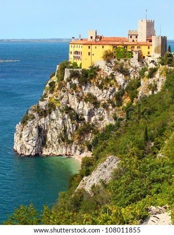 Gothic Duino castle on a cliff over the Gulf of Trieste (Adriatic sea), Italy. The castle dates back to 1389. - stock photo