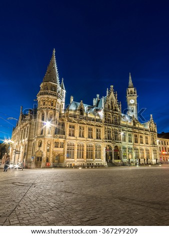Gothic facade and towers of the old Post Office in Ghent at night, Belgium