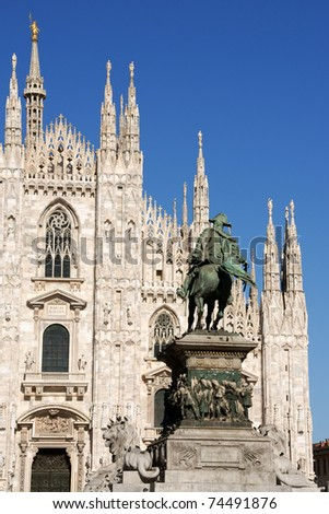 Gothic facade of Milan Cathedral in Piazza del Duomo. - stock photo
