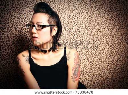Gothic girl and leopard print background