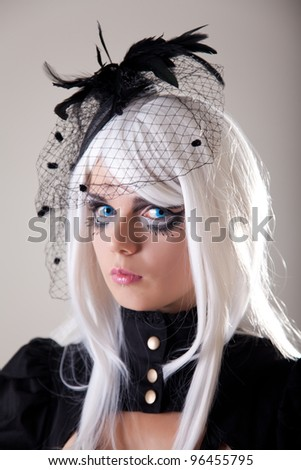 Gothic girl with creative make-up, studio shot - stock photo