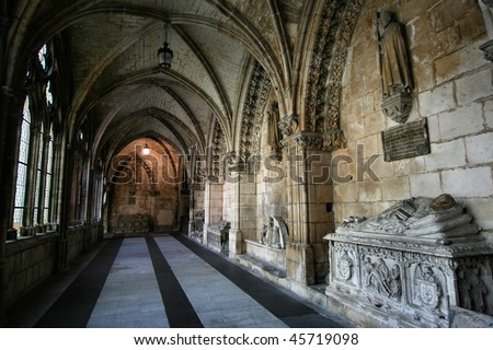 Gothic interior with medieval tombs - corridor in cathedral in Burgos, Castile, Spain. Old Catholic landmark listed on UNESCO World Heritage List.