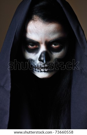 Gothic portrait of dead woman in studio - stock photo