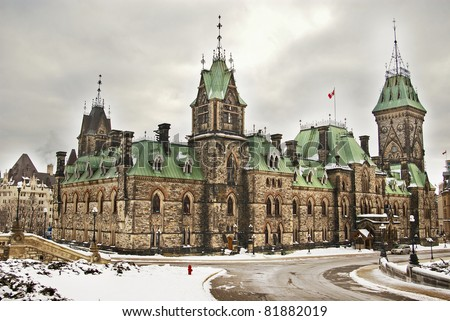 Gothic Revival Building Of Canadian Parliament In Ottawa Winter