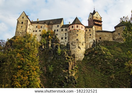 """Gothic-Romanesque castle """"Loket"""" in the Czech Republic, built on a rock, view from below - stock photo"""