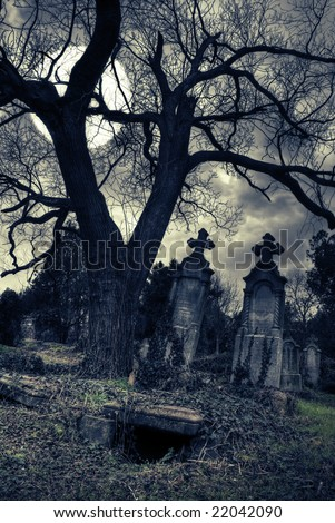 gothic scene with opened tomb - stock photo