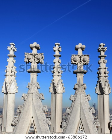 Gothic spires on blue sky background - stock photo