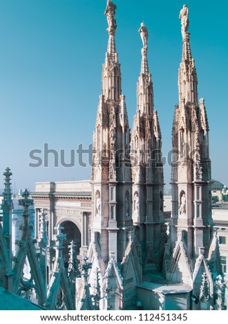 gothic spires over blue sky on roof of Milan cathedral (Duomo), Italy - stock photo