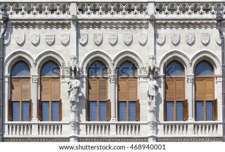 Gothic style windows with statues in Europe.