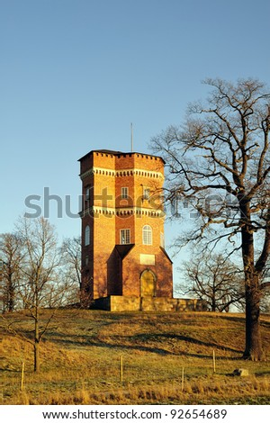 Gothic Tower is a building in the Drottningholm Palace area on Lovön outside Stockholm.  The building is since 1991 in the UNESCO World Heritage protected area of ??Drottningholm. - stock photo
