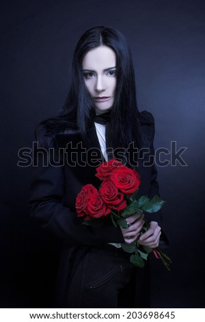 Gothic valentine. Romantic portrait in dark style with red roses. - stock photo