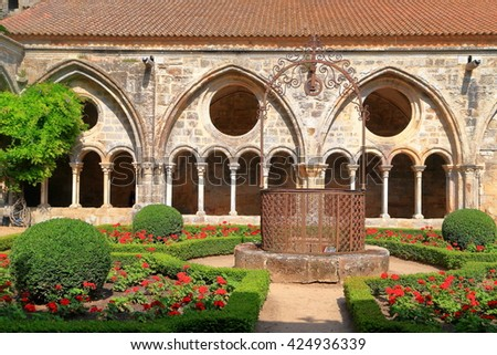Gothic walls around the patio of Fontfroide Abbey, Languedoc-Roussillon, France - stock photo