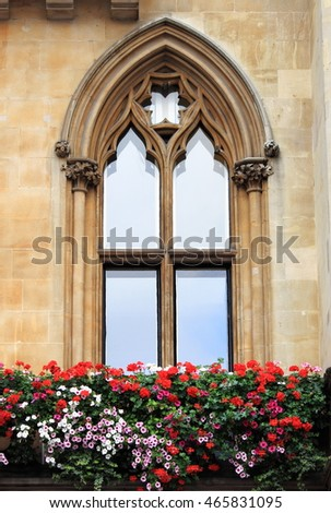 Gothic window with decorations and flowers