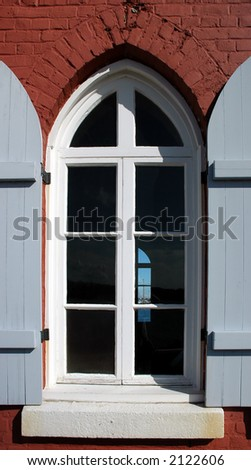 Gothic window with shutters