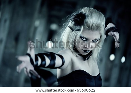 Gothic woman in black dress - stock photo