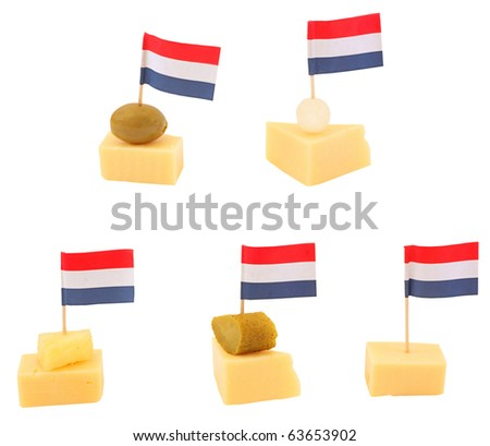 Gouda cheese snack with a dutch flag, isolated against background - stock photo