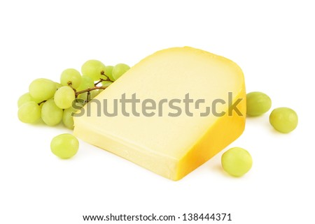 Gouda cheese with grapes on a white background - stock photo