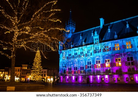 GOUDA, NETHERLANDS â?? DECEMBER 22, 2015: The city hall of Gouda in the Netherlands is lighted in several beautiful colors during Christmas holidays