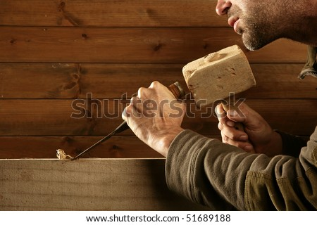 gouge wood chisel carpenter tool hammer in hand working wooden background - stock photo