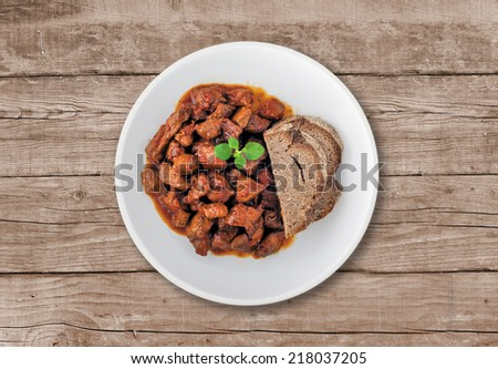 Goulash soup with bread. A hungarian traditional dish made from beef and pork - stock photo