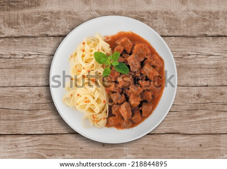 Goulash soup with potato. A Serbian traditional dish made from beef and pork. - stock photo