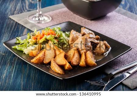 Goulash with prepared potatoes. Dark tone - stock photo