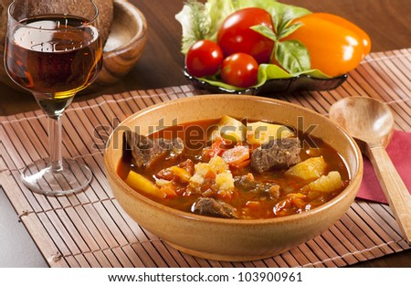 Goulash with stewed beef, potatoes, red pepper and other spices - stock photo