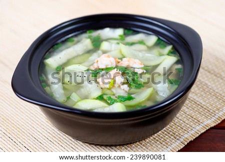 Gourd soup with shrimp and green onion, typical Vietnamese soup. - stock photo