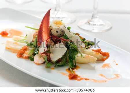 Gourmet appetizer whith lobster and quail egg - stock photo