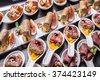 Gourmet appetizers: foie gras, venison, tuna and salmon. - stock photo