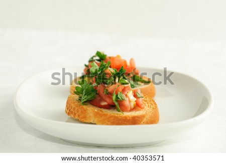 Gourmet, bruschetta made from fresh garden tomatoes and herbs, on toasted baguette. - stock photo