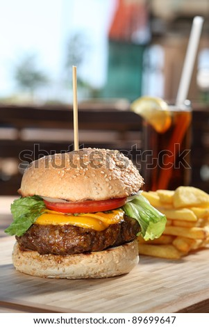 gourmet cheeseburger served - stock photo