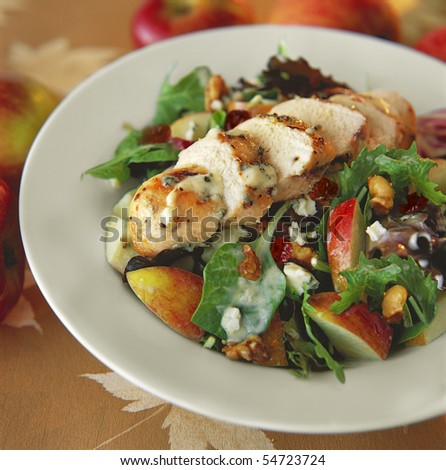 Gourmet chicken salad on a plate at a restaurant. Square shot. - stock photo