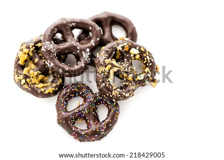 Gourmet chocolate covered pretzels on a white background.